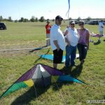 Aaron Champie, Jerry Hershey, Ann Vondriska in the sport kite staging area